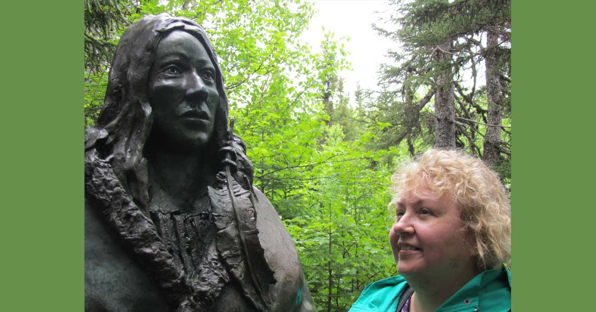 "The Rev. Dr. Joanne Mercer, rector of the Parish of Twillingate, stands beside Gerald Squires' statue ""The Spirit of the Beothuk""  in Boyd's Cove, Nfld. The statue depicts Shanawdithit, the last known living member of the Beothuk people. Submitted photo"