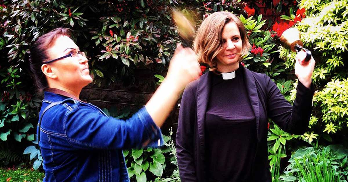 The Rev. Jessica Schaap (right), priest at St. Paul's Anglican Church in Vancouver, B.C., rings bells with a passer-by to raise awareness about missing and murdered Indigenous women as part of the #22Days project. Submitted photo