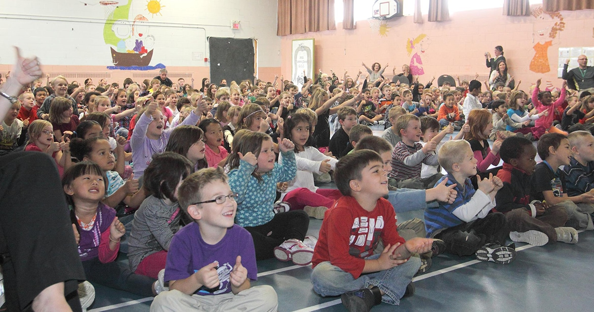 Students at Buckingham Elementary School in Buckingham, Quebec participate in an assembly marking the launch of the Daily Bread Project. Submitted photo by the Anglican diocese of Ottawa