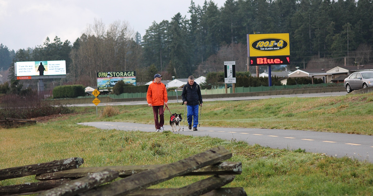 Bishop Logan McMenamie (left) trains for his 480-km walk across Vancouver Island, referred to as a Sacred Journey, which is set to begin on March 6. Submitted photo