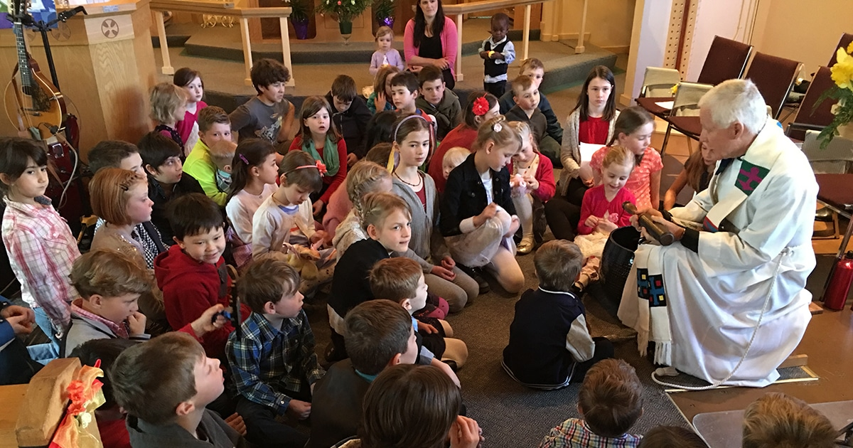The Rev Christopher Page, parish priest at St. Philip Anglican Church in Victoria, B.C., speaks to children during an Easter service. Submitted photo