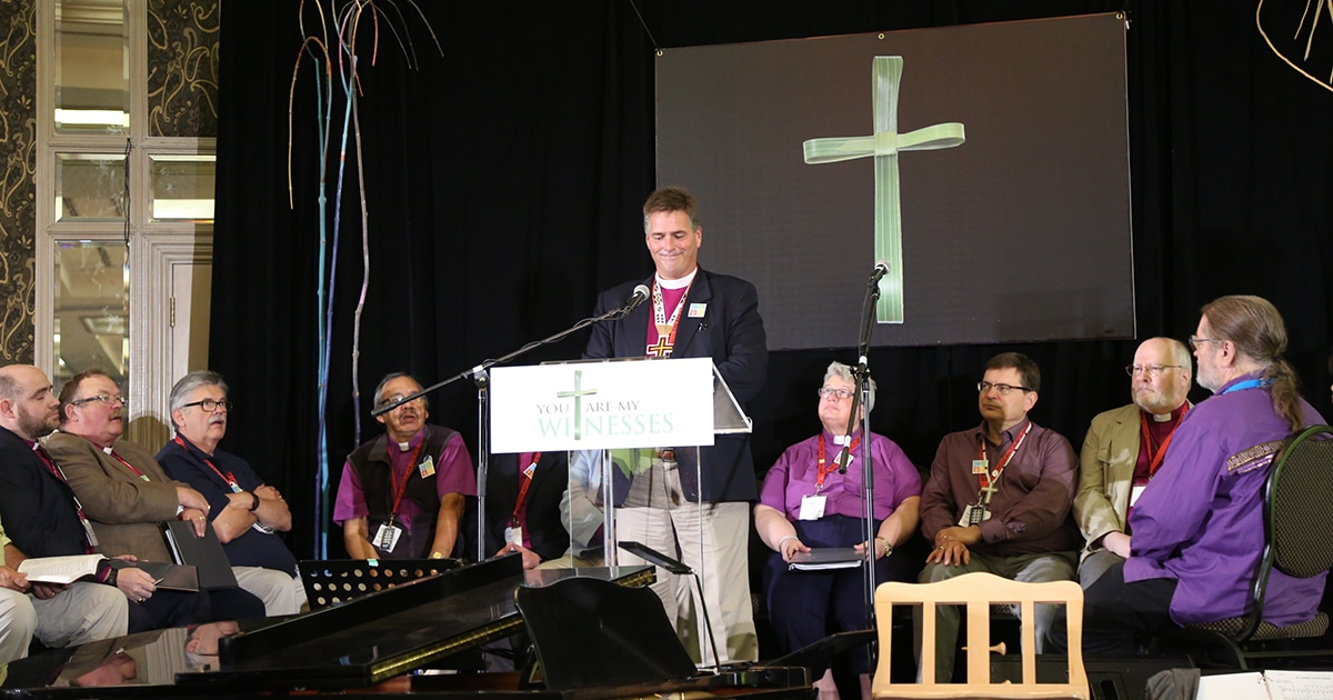 Bishop Michael Hawkins (at podium) leads a presentation by Council of the North representatives at General Synod. Photo by Art Babych
