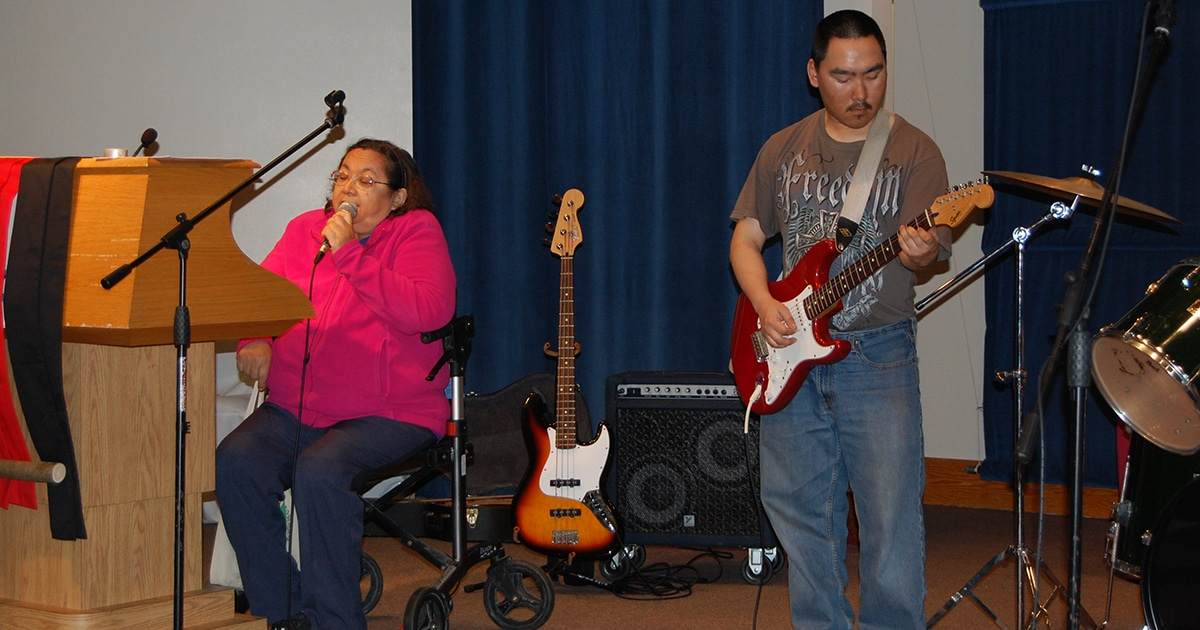 Maria Jane Highway and Nick Kigeak perform a hymn on Aug. 19 at the Sacred Circle Gospel Jam.