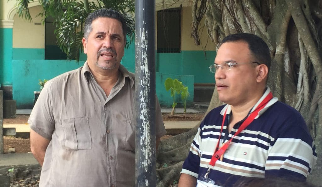 Dr. Francisco Mouza (left), director of the Colony shelter in Havana, Cuba, speaks about the facility as Justice Camp participant Gil Fat Yero translates from Spanish.