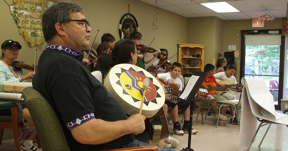 The Rev. Norm Casey performs music with youth at the Iroquois Lodge seniors' residence during the second Music for the Spirit day camp in July 2015, which took place in the village of Ohsweken in the Six Nations of the Grand River, Ont. Submitted photo