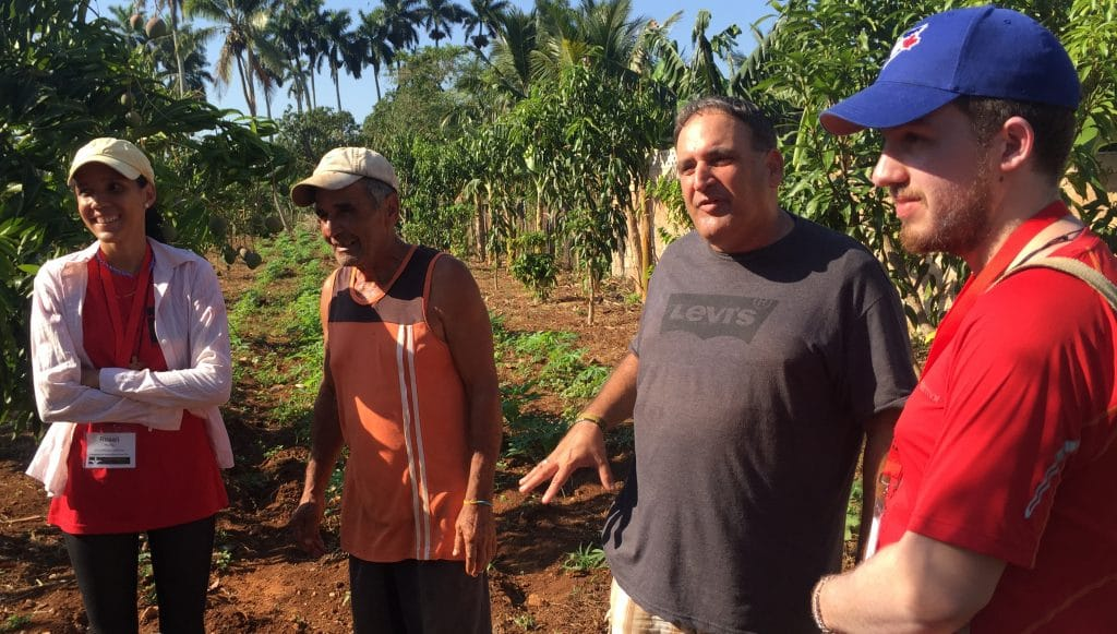 Left to right: Cuban planning team member Rosali Hardy Ramírez, local church member Enriqué, the Rev. Gerardo Logilves, and Justice Camp participant Andrew Kuhl tour the organic farm at Iglesia Santa Maria Virgen.