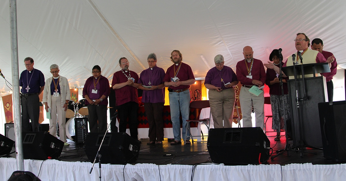 Participants take part in prayer during the 2012 Sacred Circle in Pinawa, Manitoba. National Indigenous Anglican Bishop Mark MacDonald is fourth from left.
