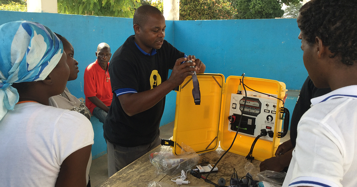 Solar suitcase demonstration at a medical clinic in Mozambique. Submitted photo by PWRDF