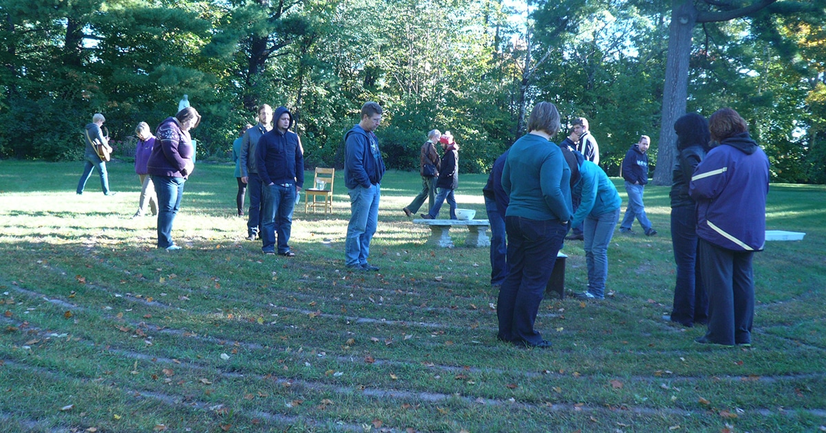 Youth ministry leaders walk around an outside labyrinth at the Galilee Retreat Centre in Arnprior, Ont. as part of a meditative activity at the 2013 Stronger Together event. Submitted photo
