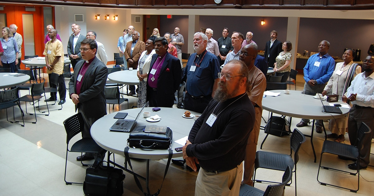 Participants in the June 22 Toronto symposium on mission and discipleship sing a hymn during opening prayers.