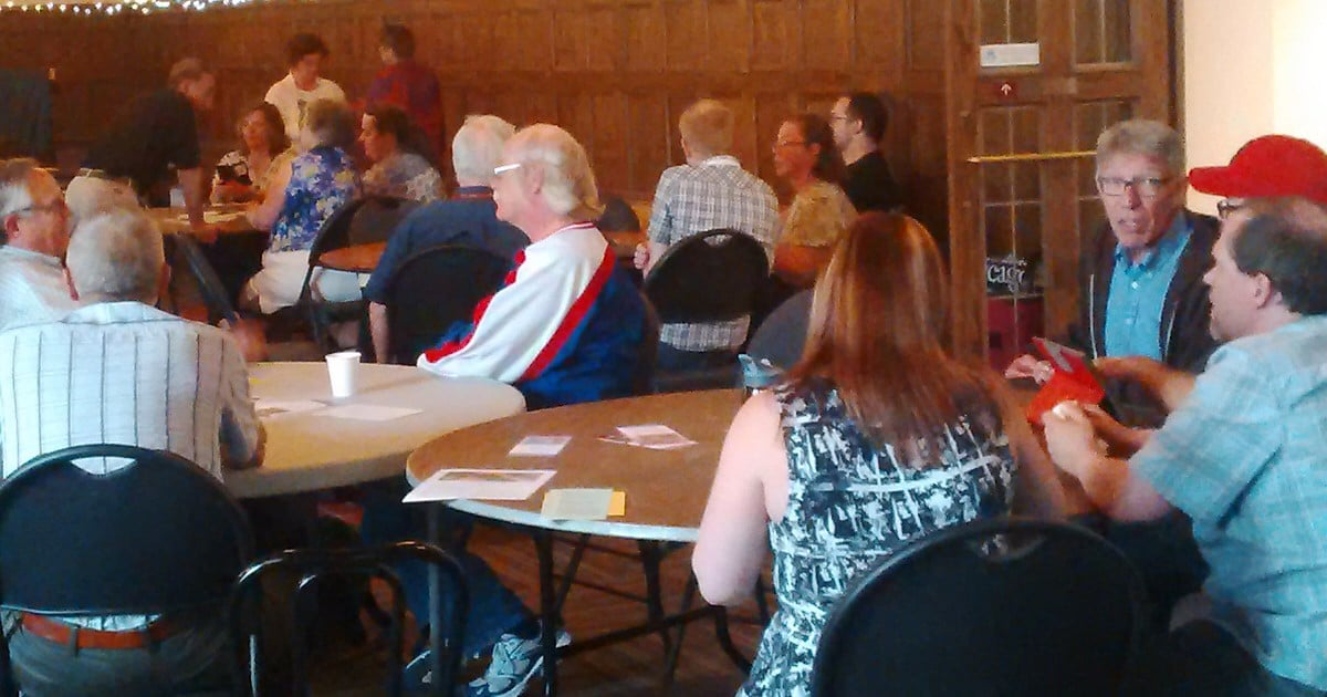 Participants converse in table groups at the third Vital and Healthy Parishes consultation, which took place from June 6-8 at the Canadian Mennonite University in Winnipeg. Submitted photo