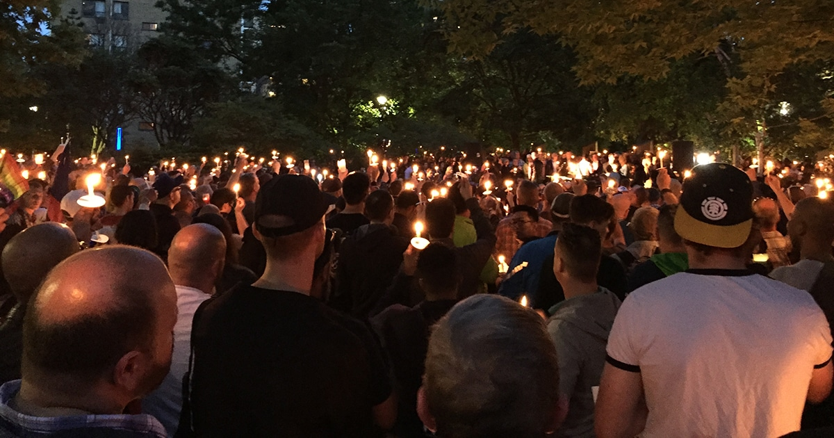 Mourners gather in Toronto for a vigil to honour the victims of the Orlando shooting. Photo by Brian Bukowski