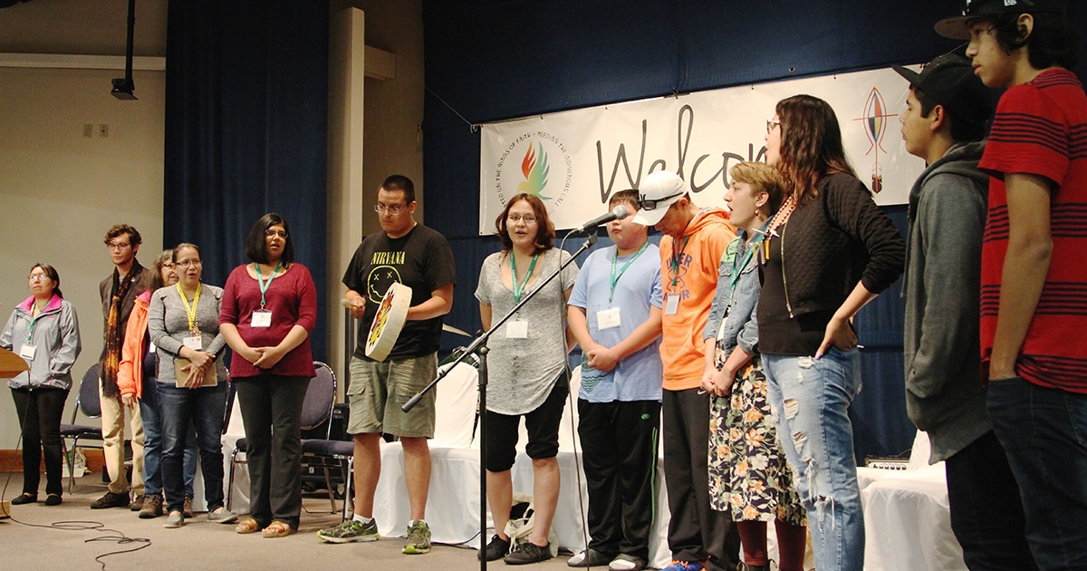 Indigenous Anglican youth and young adults perform The Women's Warrior Song at Sacred Circle.