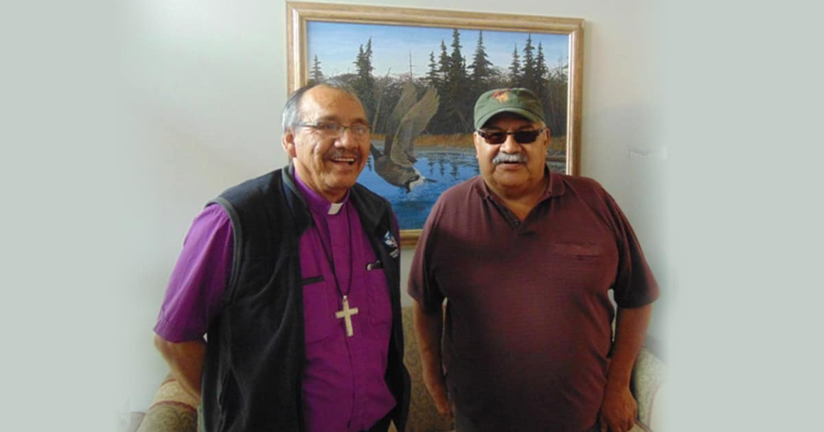 Adam Halkett (left), Bishop of Missinipi and Diocesan Indigenous Bishop of Saskatchewan , shares the news of the $15,000 grant from the Primate's World Relief and Development Fund and the $5,000 Grant from the Anglican Foundation for relief and support work by the Prince Albert Grand Council to help evacuees with PAGC Grand Chief Ron Michel. Submitted photo