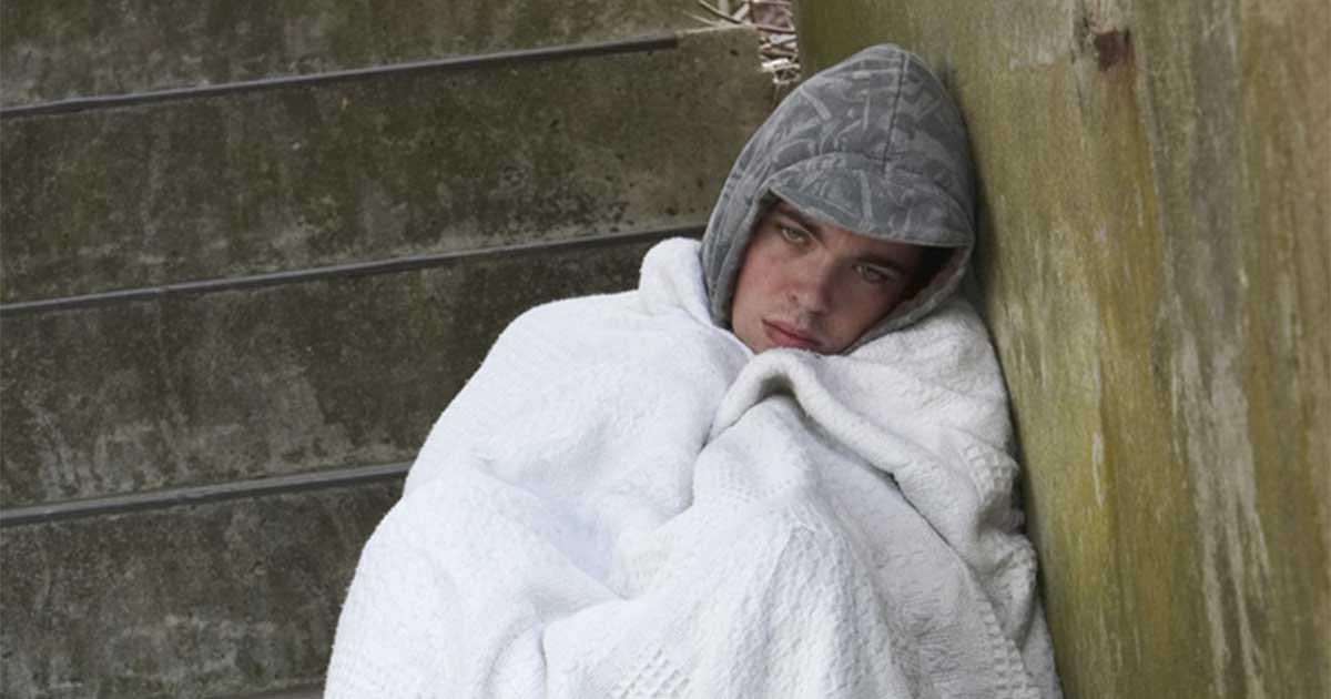 Homeless male sleeping rough. Photo via Shutterstock