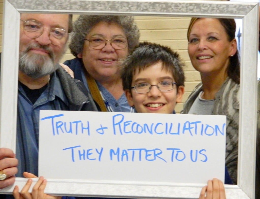 National Indigenous Anglican Bishop Mark MacDonald; Indigenous Ministries Coordinator the Rev. Canon Ginny Doctor, Blake McDonald; and Sherry Saevil, Aboriginal liasion officer, Halton Catholic and Halton District School Board pose as part of the KAIROS Put Yourself in the Picture campaign, Oakville, Ont., 2012.