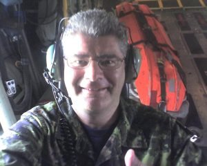 Padre Mintz in the spotter seat in the Herc