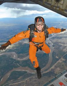 Sgt Darcy St-Laurent, a search and rescue technician (SAR tech) with 435 Squadron, 17 Wing Winnipeg, makes his 500th career jump from a CC-130 Hercules. Photo Credit: CPL COLIN AITKEN