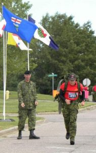 Padre Turner finishing the Iron Man with RSM CWO Bill Richards urging him on.