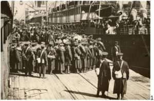 Troops of the Royal Montreal Regiment embarking at Quebec City, 1914.