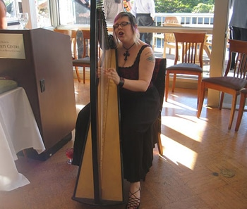 Harpist Clare Morgan plays at the National Worship Conference banquet on the University of British Columbia campus.