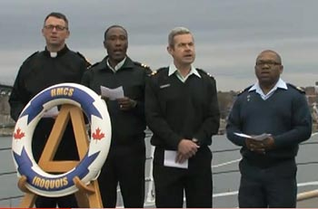 Military chaplains in Halifax sing on board the HMCS Iroquois as part of the Silent Night Project.  SILENT NIGHT PROJECT DOCUMENTARY