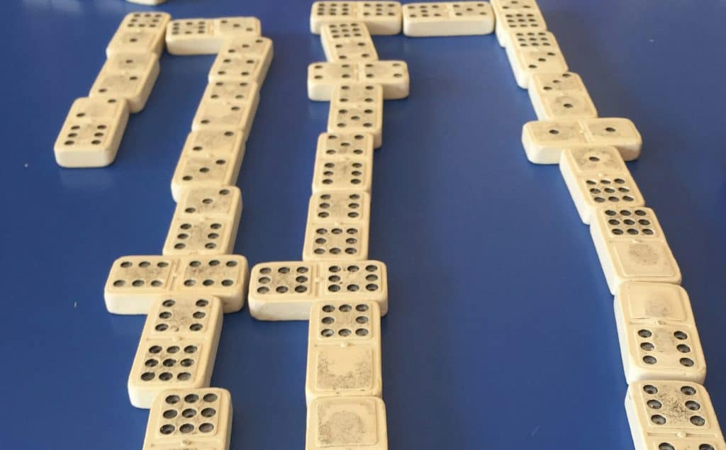 Playing dominoes.