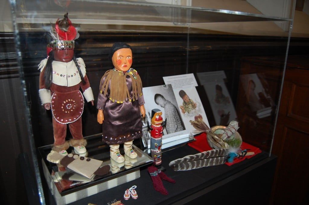 A display case from the Truth and Reconciliation exhibit features items saved from a classroom library and interest centre at a residential school, along with materials for performing a smudging ceremony as part of the Sacred Smoke Bowl Blessing. Photo by Matt Gardner