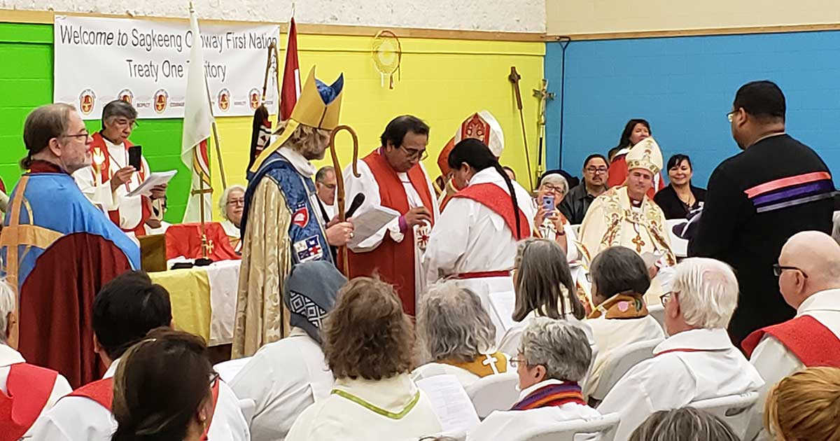 National Indigenous Anglican Bishop Mark McDonald and metropolitan of the ecclesiastical province of Ruperts land Bishop Gregory Kerr-Wilson look on as Bishop Beardy gives sacrament to laity. Photo: Melanie Delva