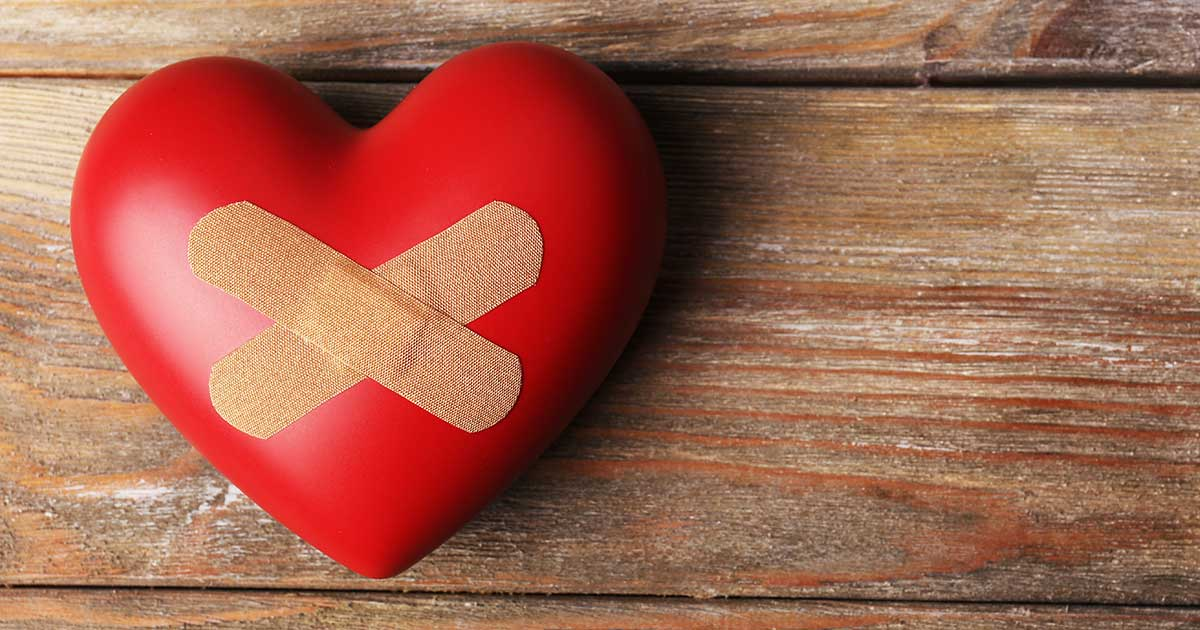 Image of a heart with bandages on a table