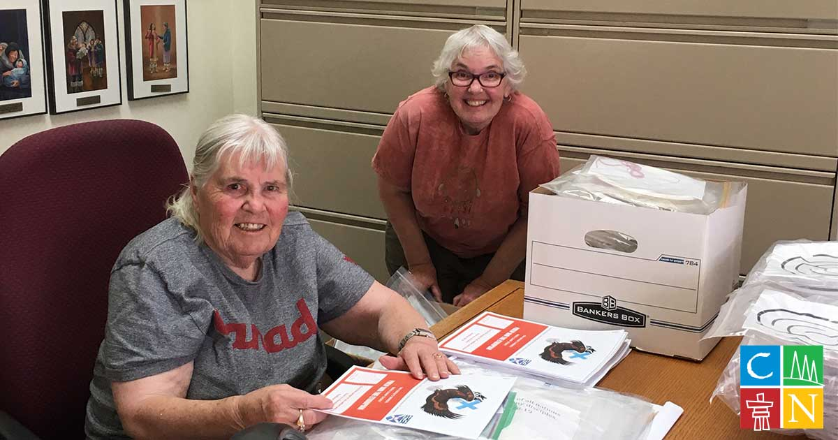 Volunteers help assemble kits for Bible Camp in a Bag.